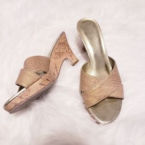 Bisou bisou gold criss cross heeled sandal. Size 7